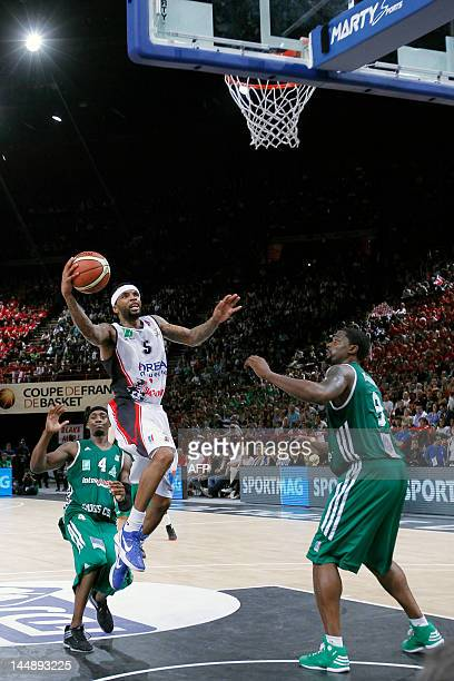 Chalon'surSoane's Malcolm Delaney tries to score in front of Limoges' Joseph Gomis and Chris Massie during the men's finale match Chalon vs Limoges...