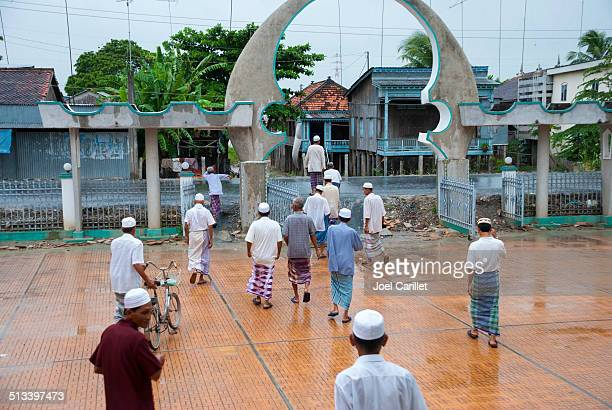 Cham Muslims leaving mosque in Chau Giang