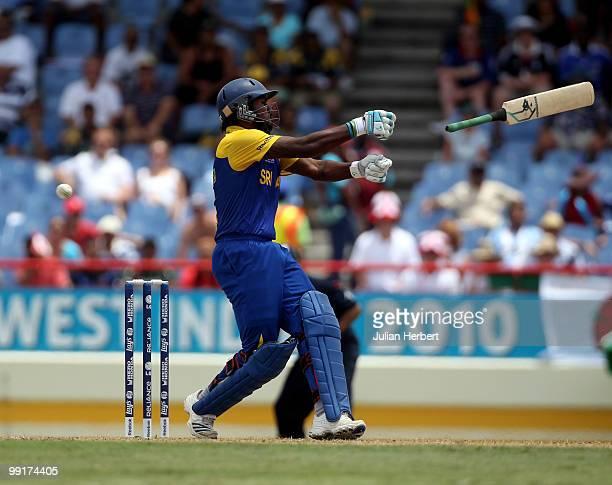 Chamara Kapugedera of Sri Lanka losses grip of his bat during the semi final of the ICC World Twenty20 between England and Sri Lanka at the Beausjour...