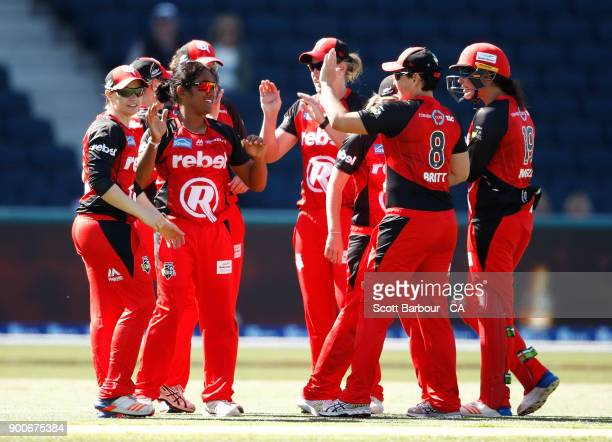 Chamari Atapattu and Claire Koski of the Renegades celebrate after dismissing Erin Burns of the Sixers during the Women's Big Bash League match...