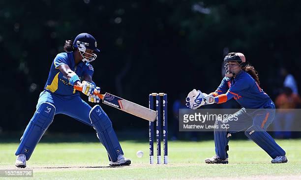 Chamari Atapattu of Sri lanka hits the ball towards the boundaryas Sulakshana Naik of India looks on during the ICC Women's World Twenty20 2012 Play...