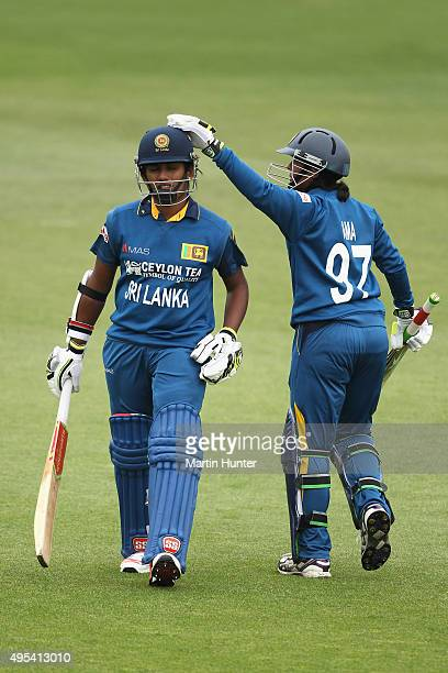 Chamari Atapattu of Sri Lanka walks after being caught for 75 runs is consoled by team mate Ama Kanchana of Sri Lanka during the First Women's One...