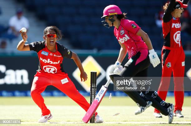 Chamari Atapattu of the Renegades celebrates after running out Sara McGlashan of the Sixers during the Women's Big Bash League match between the...