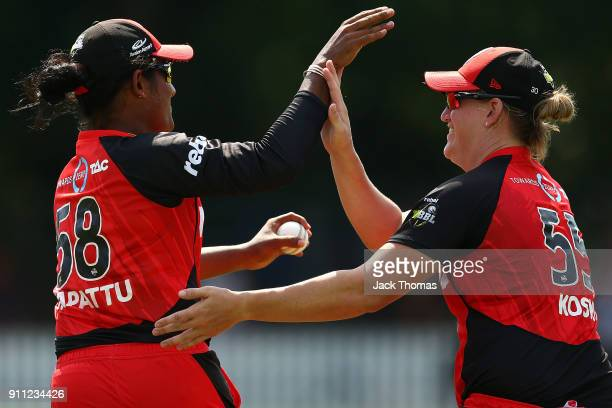 Chamari Atapattu of the Renegades celebrates catching a ball with team mate Claire Koski during the Women's Big Bash League match between the Perth...