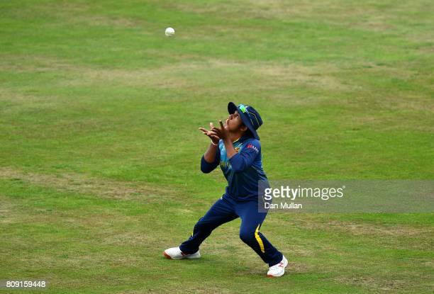 Chamari Athapaththu of Sir Lanka takes a catch to claim the wicket of Jhulan Goswami of India during the ICC Women's World Cup 2017 match between Sri...
