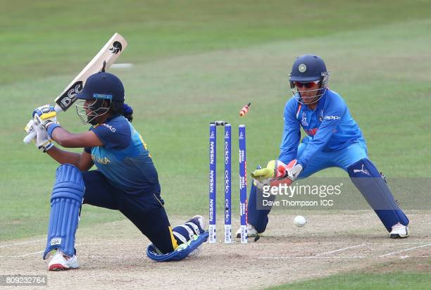 Chamari Athapaththu of Sri Lanka is bowled out by Poonam Yadav of India during the ICC Women's World Cup match between Sri Lanka and India at The...