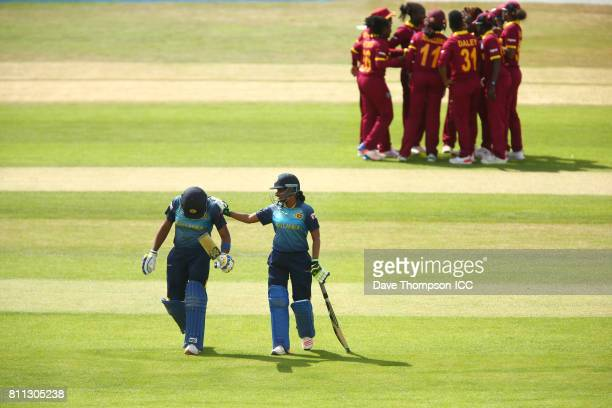 Chamari Athapaththu of Sri Lanka is consoled by team mate Shashikala Siriwardena of Sri Lanka after losing her wicket during the ICC Women's World...