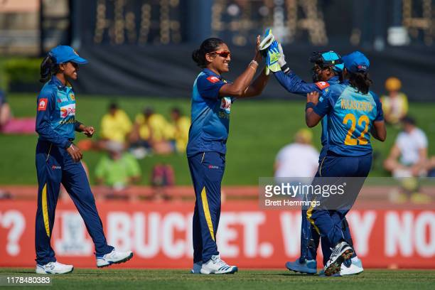 Chamari Athapathtu of Sri Lanka celebrates taking the wicket of Beth Mooney of Australia during game three of the Women's Twenty20 International...