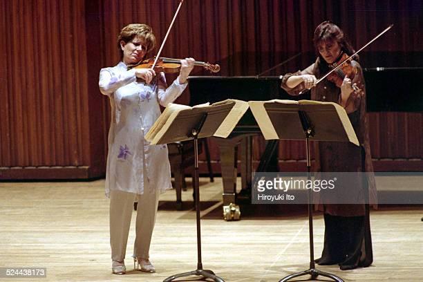 Chamber Music Society performing at Alice Tully Hall on Friday night May 7 2004This imageIda Kavafian left and Ani Kavafian performing Toru...