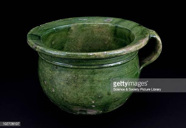 Chamber pot. England, 1501-1700. Chamber pot, made of green glazed earthenware. England, 1501-1700.