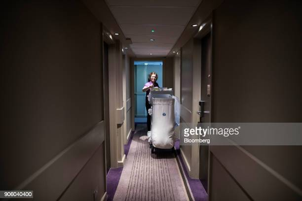 A chambermaid selects items from a service trolley at a Premier Inn hotel operated by Whitbread Plc in London UK on Wednesday Jan 17 2018 The hotel...