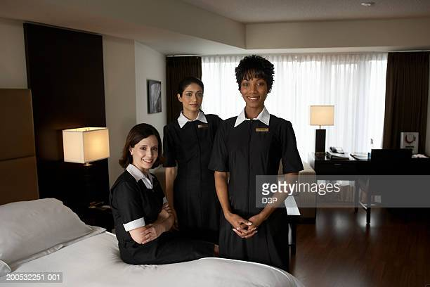 Chambermaids in hotel room, portrait