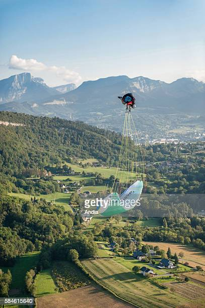 Chambery acrobatic paragliding over the lake Lac du Bourget Paraglider flinging in the air