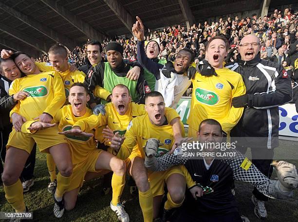 Chambery's players celebrate after winning the French Cup football match Chambery vs Sochaux on February 2, 2001 at Chambery Stadium. AFP PHOTO /...