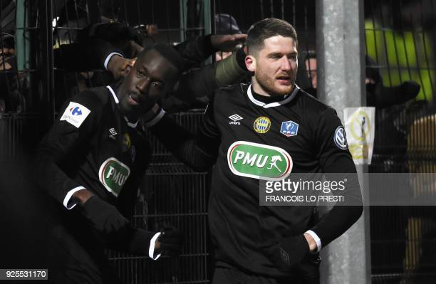 Chambly's Lassana Doucoure celebrates after scoring a goal during French Cup quarterfinal football match between Chambly and Strasbourg on February...