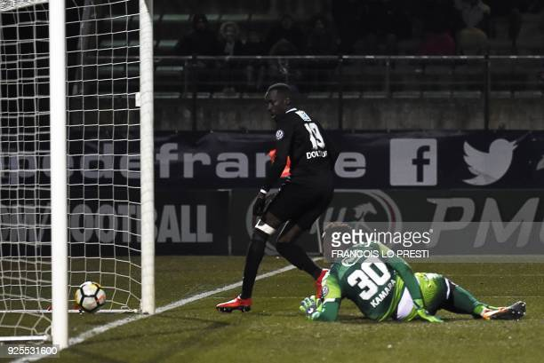 Chambly's Lassana Doucoure scores a goal during French Cup quarterfinal football match between Chambly and Strasbourg on February 28 at the Pierre...