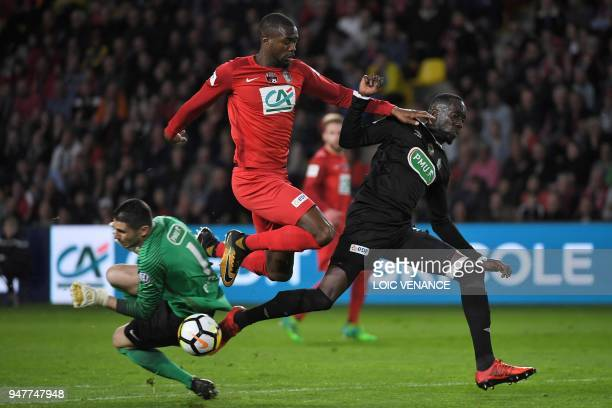 TOPSHOT Chambly's midfielder Lassana Doucoure vies with Les Herbiers' defender Diaranke Fofana and Les Herbiers' goalkeeper Matthieu Pichot during...