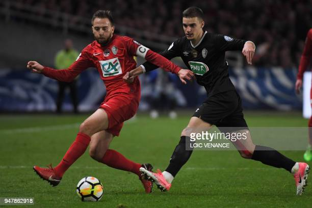 Chambly's Romain Montiel fights for the ball with Les Herbiers Sebastien Flochon during the French cup semi-final match between Les Herbiers and...