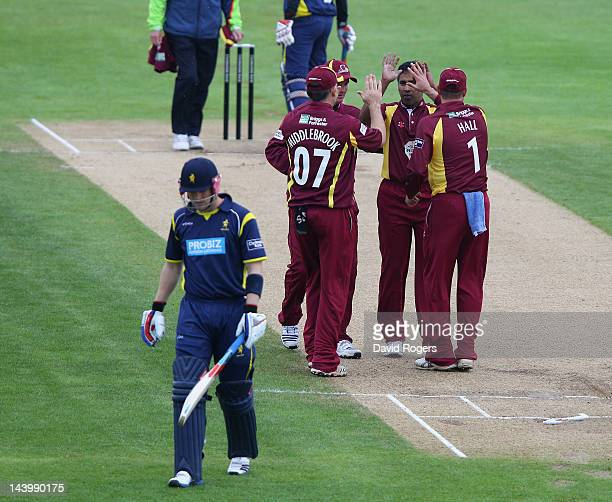 Chaminda Vaas of Northamptonshire celebrates with team mates after bowling Michael Thornely during the Clydesdale Bank Pro40 match between...
