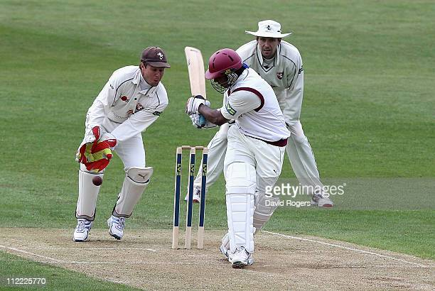 Chaminda Vaas of Northamptonshire plays the ball past Kent wicket keeper Geraint Jones during the LV County Championship Division Two match between...