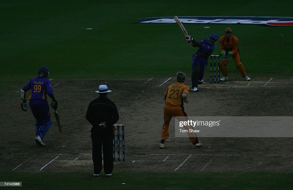 Chaminda Vaas of Sri Lanka hits out in the dark during the ICC Cricket World Cup Final between Australia and Sri Lanka at the Kensington Oval on April 28, 2007 in Bridgetown, Barbados.