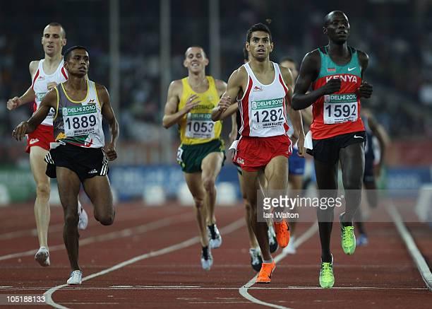 Chaminda Wijekoon of Sri Lanka, Tom Lancashire of England and James Magut of Kenya compete in the men's 1500 metres first round at Jawaharlal Nehru...