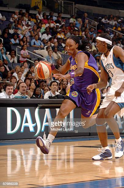 Chamique Holdsclaw of the Los Angeles Sparks drives against DeLisha MiltonJones of the Washington Mystics during a WNBA game on May 26 2005 at the...