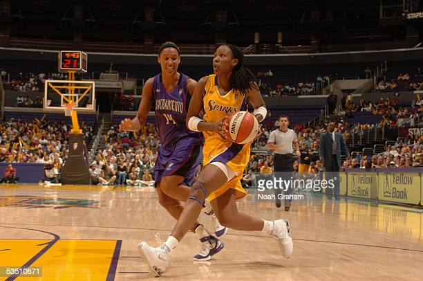Chamique Holdsclaw of the Los Angeles Sparks drives around Nicole Powell of the Sacramento Monarchs on August 16 2005 at Staples Center in Los...