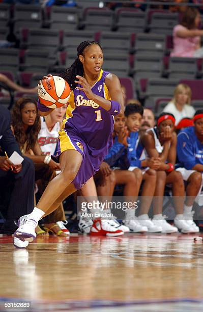 Chamique Holdsclaw of the Los Angeles Sparks drives to the basket against the Detroit Shock on June 26 2005 at the Palace of Auburn Hills in Auburn...