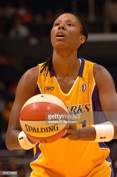 Chamique Holdsclaw of the Los Angeles Sparks gets set to shoot a free throw against the Phoenix Mercury on July 2 2005 at Staples Center in Los...