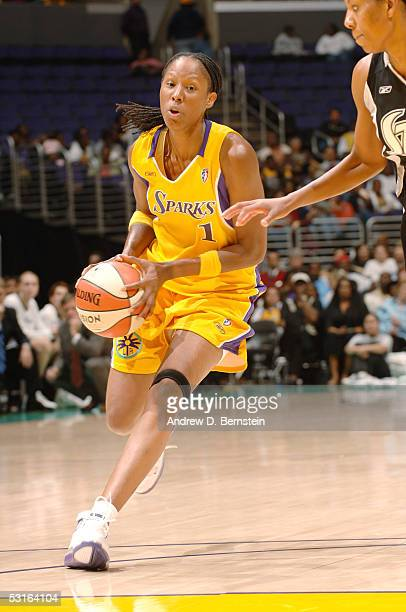 Chamique Holdsclaw of the Los Angeles Sparks moves the ball against the San Antonio Silver Stars in the game on May 31 2005 at Staples Center in Los...