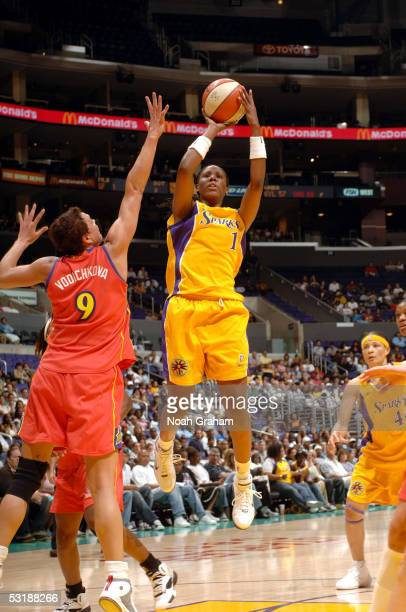 Chamique Holdsclaw of the Los Angeles Sparks puts up a shot over Kamila Vodichkova of the Phoenix Mercury on July 2 2005 at Staples Center in Los...