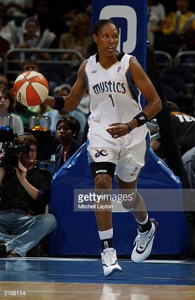 Chamique Holdsclaw of the Washington Mystics brings the ball upcourt during the WNBA game against the Sacramento Monarchs at MCI Center on June 18...