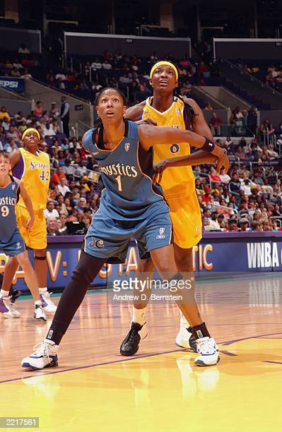 Chamique Holdsclaw of the Washington Mystics is defended by DeLisha Milton of the Los Angeles Sparks during the WNBA game at Staples Center on July...