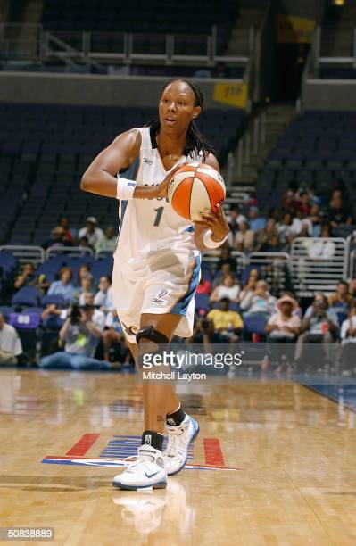 Chamique Holdsclaw of the Washington Mystics looks to pass during the preseason game against the Indiana Fever on May 11 2004 at MCI Center in...