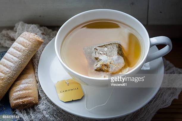 Chamomile tea and biscuits on window sill