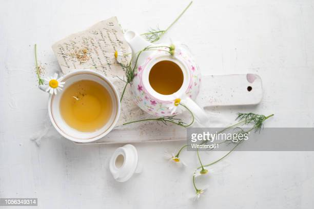 Chamomile tea in pot and cup