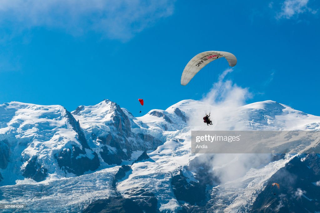 Chamonix-Mont-Blanc (Upper Savoy, French Alps, eastern France): paragliders flying over the Mont Blanc Massif.