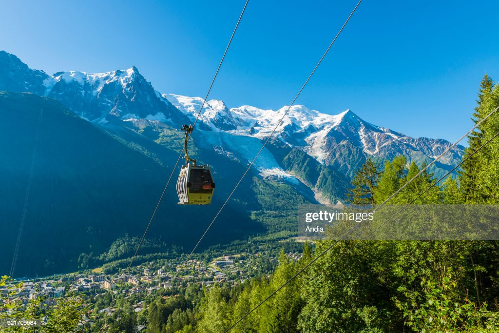 Chamonix-Mont-Blanc (Upper Savoy, French Alps, eastern France): the Chamonix Valley with the Planpraz cable-cars and snow-capped mountains of the Mont Blanc Massif with the Bossons glacier.