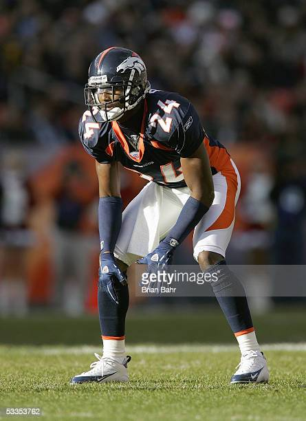 Champ Bailey of the Denver Broncos gets into position during the game against the Miami Dolphins on December 12 2004 at Invesco Field at Mile High...