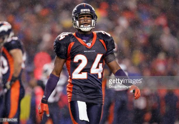 Champ Bailey of the Denver Broncos walks on the field during the game against the Baltimore Ravens on October 9 2006 at Invesco Field at Mile High in...