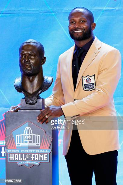 Champ Bailey poses with his bust during his enshrinement into the Pro Football Hall of Fame at Tom Benson Hall Of Fame Stadium on August 3, 2019 in...