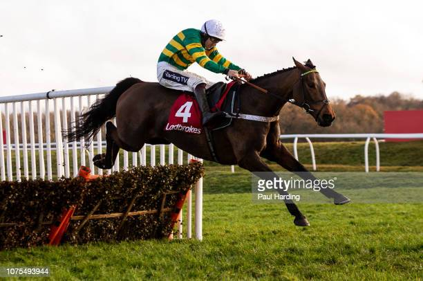 Champ ridden by Aidan Coleman jumps the last fence on the way to winning the 1350 Ladbrokes Handicap Hurdle at Newbury Racecourse on December 01 2018...