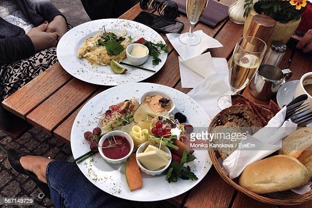 Champagne And Brunch Served Wooden Table