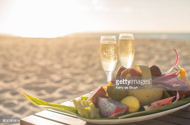 Champagne and fruit platter on the beach in Seychelles.