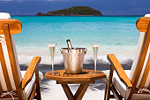 champagne and recliners on a tropical beach in the Caribbean
