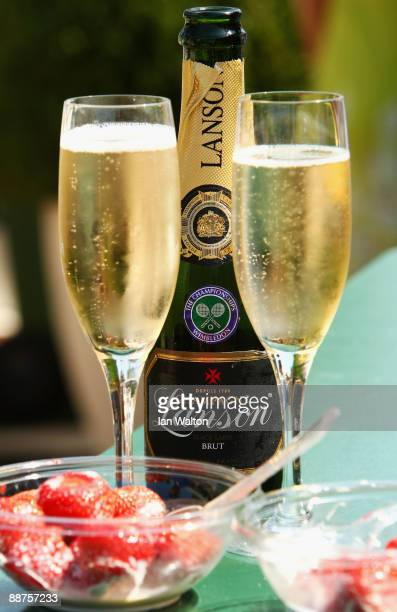 Champagne and strawberries and cream on Day Eight of the Wimbledon Lawn Tennis Championships at the All England Lawn Tennis and Croquet Club on June...