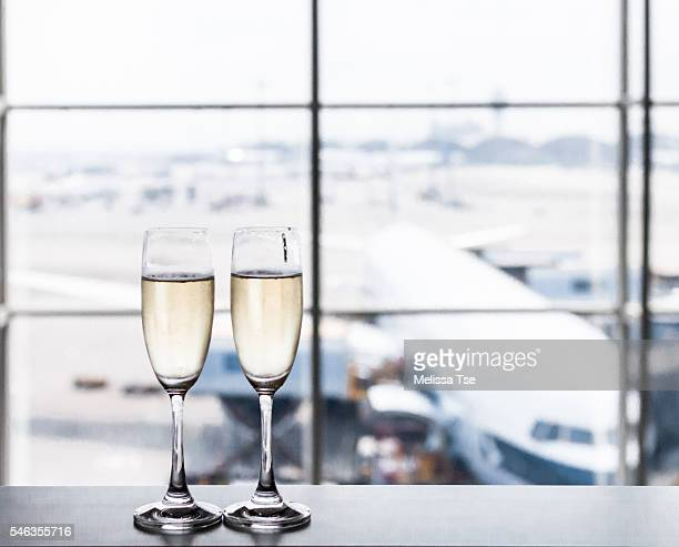 champagne at the airport - hong kong international airport stock photos and pictures