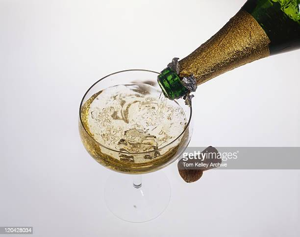 Champagne being poured into glass, close-up