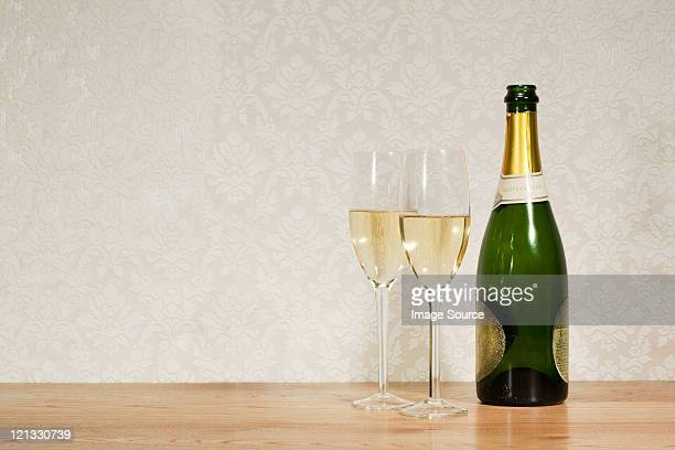 champagne bottle and two glasses - champagne photos et images de collection